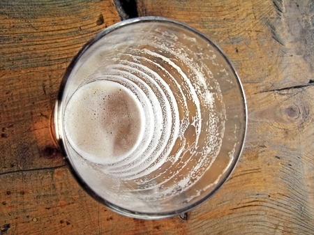 shrinking: Drinking from the cup of a shrinking characters drink known as circular traces foam. Stock Photo