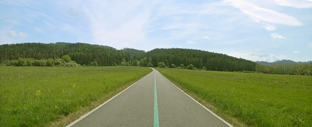 predilection: A bicycle path to the mountains panorama photo during sports activities. Stock Photo