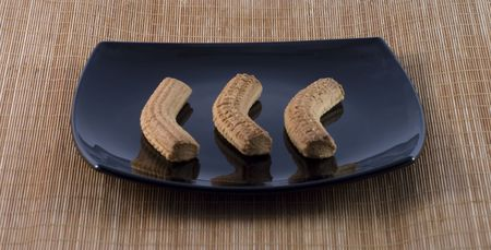 thea: Three Italian typical biscuits on a black plate