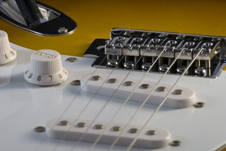 Closeup of electric guitar Stratocaster-type, white and sunburnt, with strings Stock Photo - 4301481