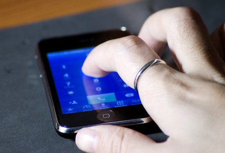 sensible: Hand digiting on a touch screen phone
