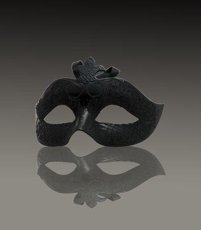 A venetian black mask on gray gradient background