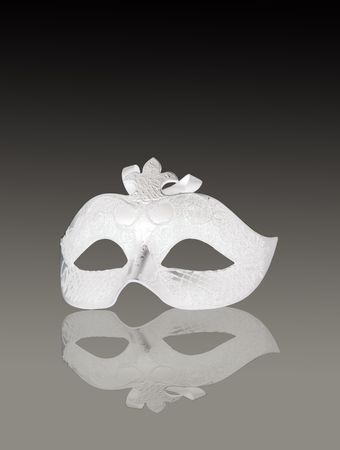 A venetian white mask on gray gradient background photo