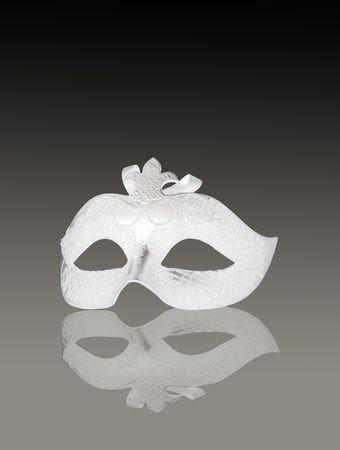 phantom: A venetian white mask on gray gradient background