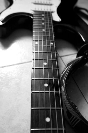 Black and white close up of neck of guitar