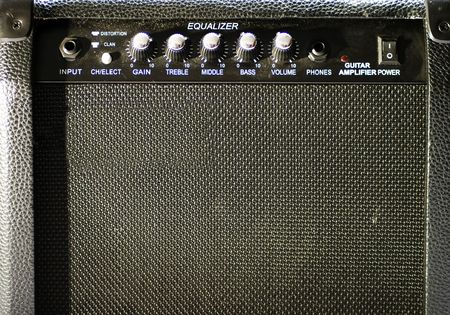 An old guitar black amp, frontal view photo