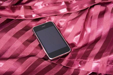 Last generation telephone on a white tissue background Stock Photo