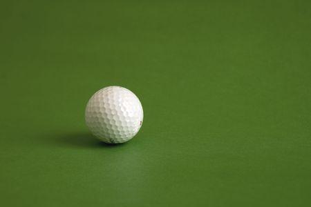 A white golf ball on a big green Stock Photo