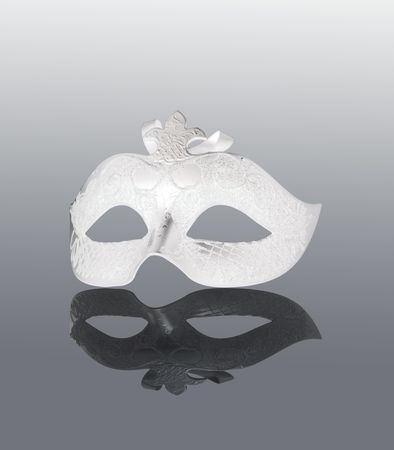 White Mask with black reflection, over gray background