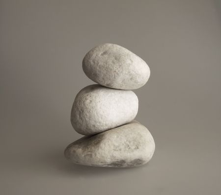 Three pebbles in a pile