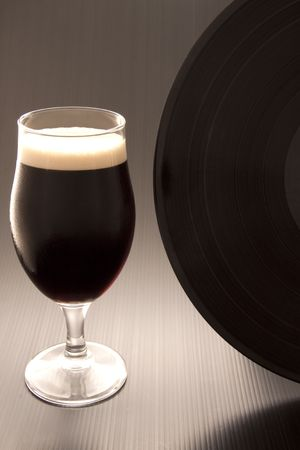 Close up of a glass of irish alcohol with a vinyl record Stock Photo