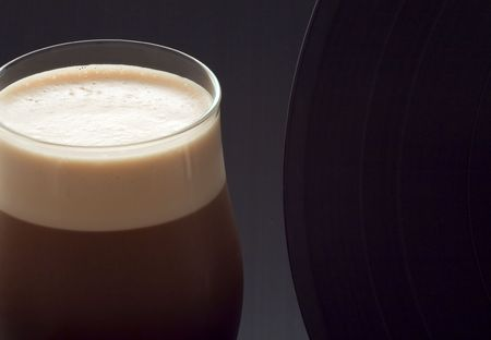 Close up of a glass of irish alcohol with a vinyl record photo