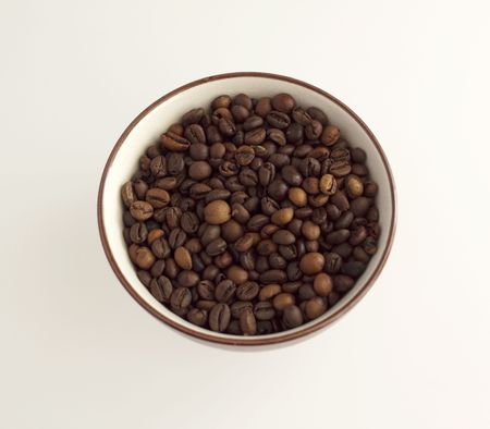percolate: A cup full of coffee beans, white background Stock Photo