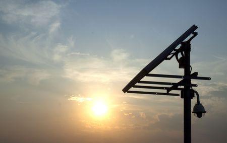 Closeup of a solar panel, blue sky, sun setting Stock Photo