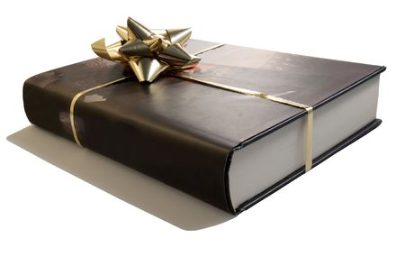 A brown book with a golden gift packaging
