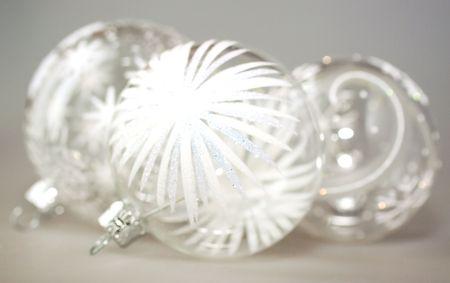 Shiny Christmas glass balls over gray background