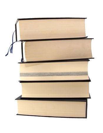 Great and heavy books in a pile over white background photo