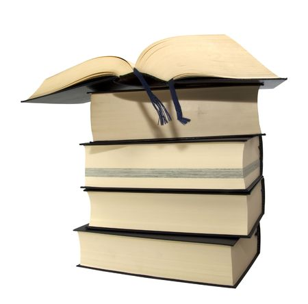Great and heavy books in a pile over white background Stock Photo