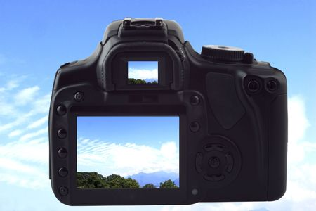 A black reflex photocamera shooting landscape of blue sky with clouds, same image on live view and viewfinder Stock Photo