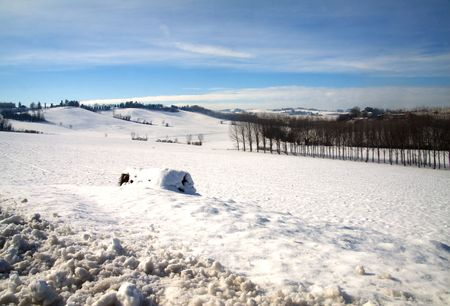 Landscape of a hill with a snow-covered track Stock Photo