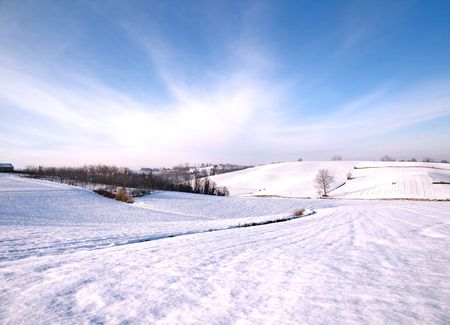 Landscape of a hill with a snow-covered track photo