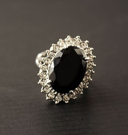 Precious ring with black stone and little diamonds Stock Photo