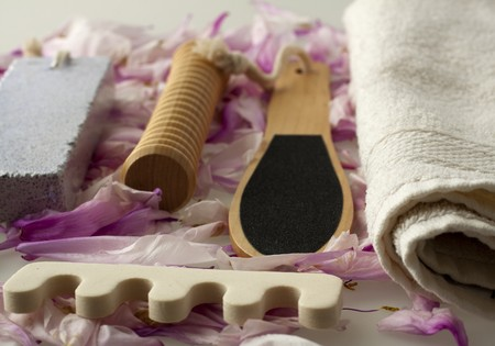 Tools for pedicure over rose petals of flowers Stock Photo - 6993305