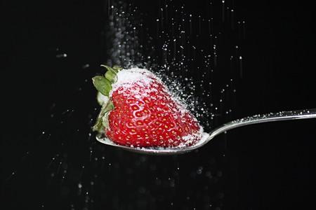 fallin: Strawberry on a spoon with sugar fallin on