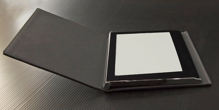 An eBook reader over a black background Stock Photo - 7082592