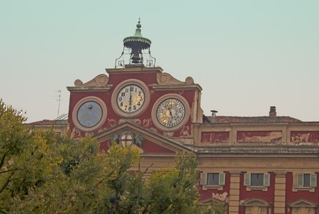 Clocks for hour, day and sun over a building Stock Photo - 8061187