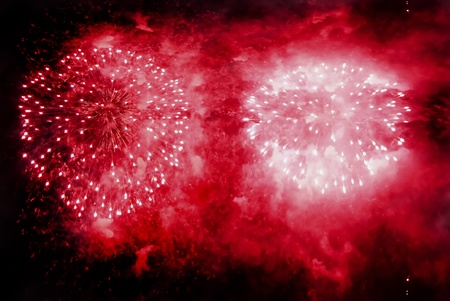 Red fireworks exploding over a completely black sky Stock Photo - 8294999