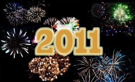 Multicolor fireworks celebrating New Year 2011, written in golden Stock Photo - 8295002
