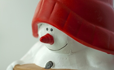 Closeup of face of a puppet of a Snowman with red hat Stock Photo - 8294994