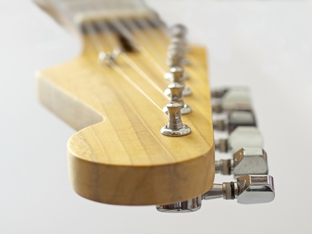 Close up of headstock of an electric guitar, over white Stock Photo - 8529594
