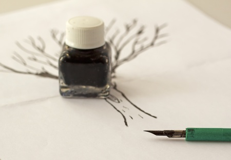Pen for indian ink with little bottle over a drawing Stock Photo - 8581215