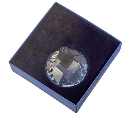 Round jewel of crystal in a blue box photo