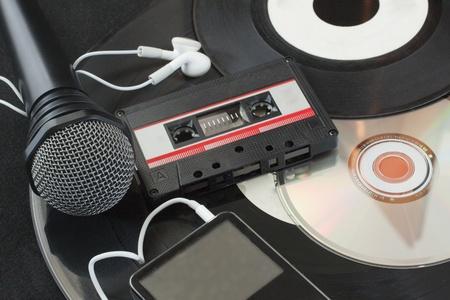 Microphone, vinyl discs, audiotape, mp3 player, cd over black Stock Photo