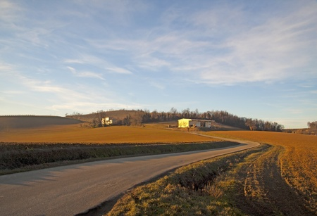 Landscape of a hill under a blue sky, with road getting inside Stock Photo - 8773130