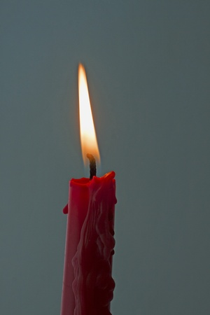 lite: Lite red candle over a dark gray background