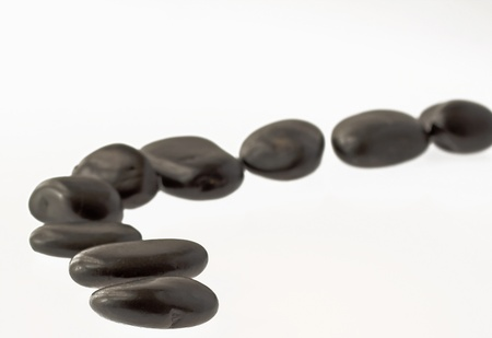 disposed: Black stones for stone massage disposed as a road