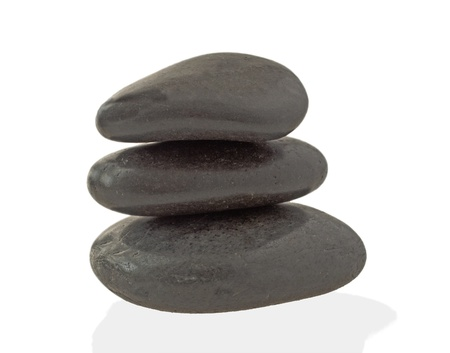 Three black stones in pile with reflection photo