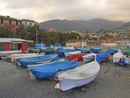 Series of still boats near the sea, under a cloudy sky Stock Photo - 9180313