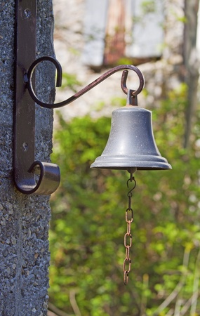 rin gong: A little old bronze bell with chain  Stock Photo