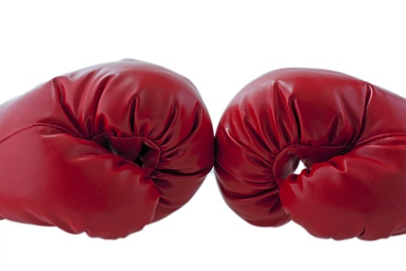 blue gloves: Red boxe gloves fronting each other over white background