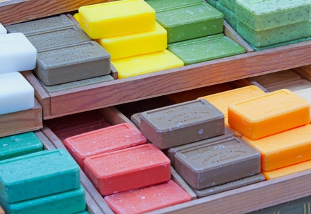 Many soaps of different colors on a bank