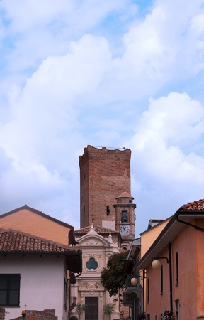 Tower coming out of skyline of a little town Stock Photo - 9913863