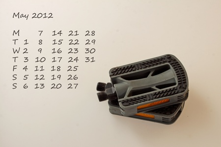 Page of calendar of 2012. Month of May, sport of cycling photo