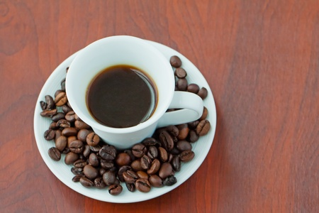 Close up of a cup of coffee with coffee beans Stock Photo - 10267766