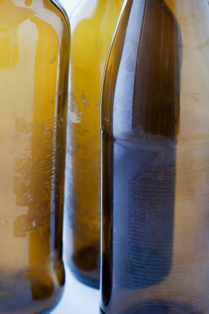 6 pack beer: Close up of empty bottles of beer Stock Photo