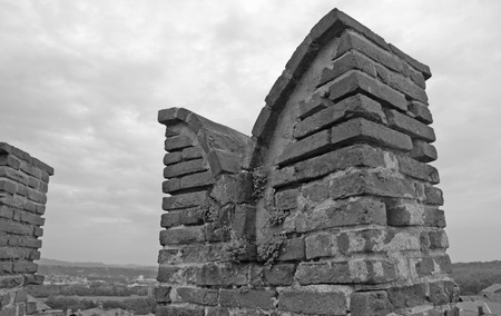 Close up of the battlement of an old castle, black and white